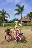 Wooden dolls cycling. Royalty Free Stock Image