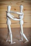 Wooden dolls dancing Stock Image