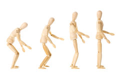 Wooden dolls with different postures Stock Image