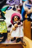 Wooden dolls dressed in different outfits. handmade wooden dolls hanging as a display. decorative dolls Stock Images