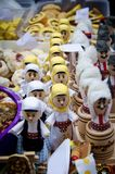 Wooden dolls dressed in traditional costume. Small wooden dolls dressed in traditional costume for street food festival royalty free stock images