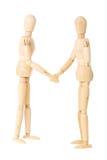 Wooden dolls handshake Stock Photo
