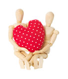 Wooden dolls hold heart Royalty Free Stock Photography