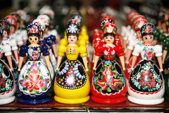 Wooden dolls in hungarian folk costumes as souvenir in row Royalty Free Stock Images
