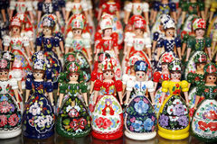 Wooden dolls in hungarian folk costumes as souvenir in row Royalty Free Stock Photography
