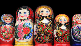 Wooden dolls standing in a row Stock Images