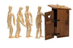 Wooden dolls in waiting line. For toilet on white Stock Photography