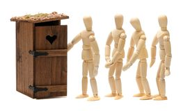 Wooden dolls waiting for toilet Stock Images
