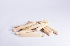 Wooden dolly clothes pegs on white background Royalty Free Stock Image