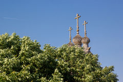 Wooden dome of the church out from behind trees Royalty Free Stock Photos