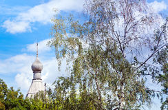 Wooden dome of russian church and birch Stock Photo