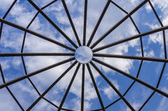 Wooden dome structure. Through which the blue sky is visible Royalty Free Stock Image