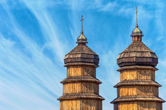 Wooden domes of the old church. Wooden dome of the old church against the sky with light clouds. Ukraine, Ivano-Frankivsk Royalty Free Stock Photography