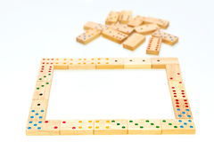 Wooden domino game on white Royalty Free Stock Photography