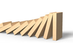 Wooden Dominoes Falling With Last Piece Standing Royalty Free Stock Images