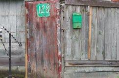 Wooden doo. Old wooden door in the wooden fence Stock Photos