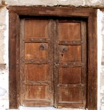 Wooden door. Closed old-fashioned wooden door royalty free stock photography