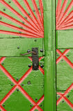 Wooden door. Old carved wooden door green/red royalty free stock photos