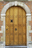 Wooden Door. A closeup on a brown wooden door on a brick building royalty free stock photo