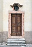 Wooden door. With marble for access to small church in the province of Trento royalty free stock photography