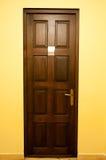 Wooden door with golden handle Royalty Free Stock Image