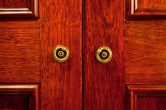 Wooden door. Closeup of the wooden door of an oriental styled closet royalty free stock images