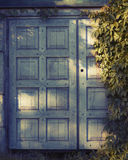 Wooden door. And sun light royalty free stock images