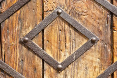 Wooden door. Reinforcement of metal, old wooden door of a church royalty free stock images