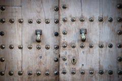 Wooden door. Old wooden door with metallic details Royalty Free Stock Photos