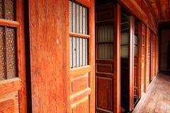 Wooden door. Open wooden door and corridor in old house Royalty Free Stock Photo