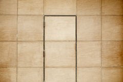 Wooden door. In a street, textured background Royalty Free Stock Image