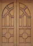 Wooden door. S of the temple in Bangkok Stock Photography