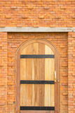 Wooden Door. And red brick wall Stock Images
