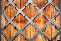 Wooden door. With wrought pattern Royalty Free Stock Images