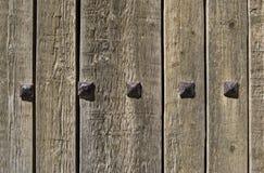 Wooden door. Wooden ancient door with iron pieces Stock Photos