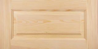 Wooden door. Wooden pine door close-up Royalty Free Stock Photography