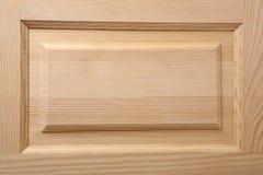 Wooden door. Wooden pine door close-up Stock Image