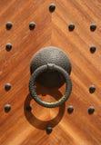 Wooden Door. A strong wooden door with heavy rivets royalty free stock photos
