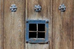 Wooden door window detail Royalty Free Stock Photo