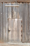 Wooden door. Wooden wall with door and light royalty free stock images