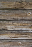 Wooden Door. Old door made of knotted wood Royalty Free Stock Image