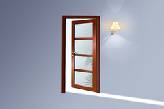 A wooden door. Door from a room or in a room. An input in in something light Stock Photo
