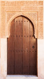 A wooden door in Alhambra palace Stock Photos