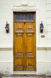 Wooden door and antique luminaires Stock Image