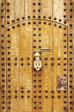 Wooden door with arab style doorknob Stock Images