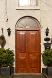 Wooden door with an arch. Wooden brown door with an arch on the top Royalty Free Stock Photography