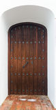 Wooden  door in  arch Royalty Free Stock Photography