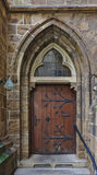 Wooden door with archway and steps Royalty Free Stock Images