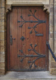 Wooden door with archway and steps Royalty Free Stock Image