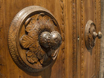 Wooden door. In Arezzo in the foreground with a rosette Stock Photo